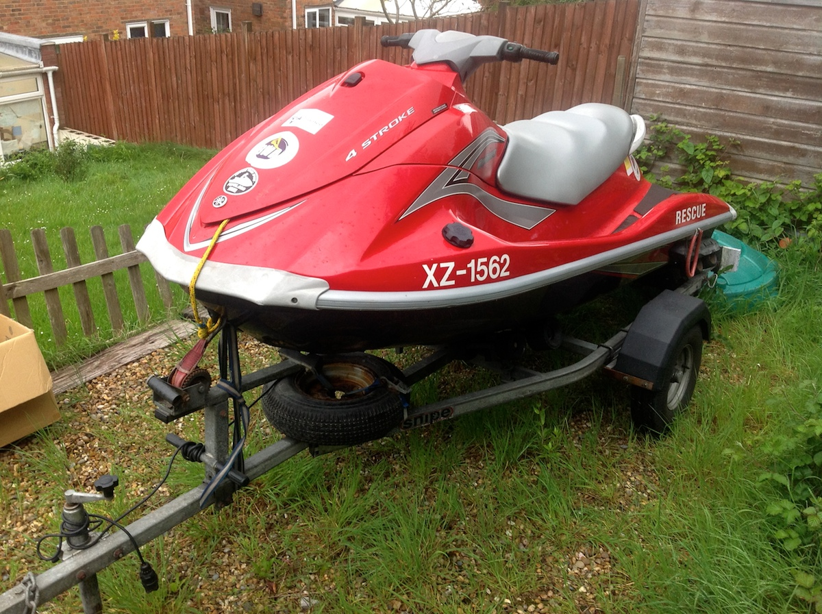 Red jet ski with trailer